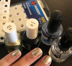 Essie: Good As Gold (gold) and Licorice (black)