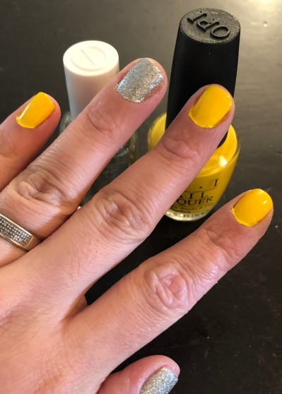 Essie: Beyond Cozy (glitter) and OPI: Exotic Birds Do Not Tweet (yellow)